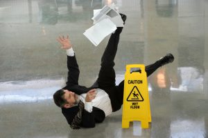 Man slipping near caution sign