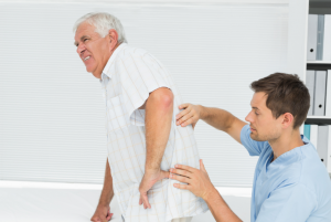 doctor treating patient with back pain