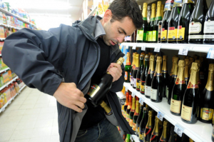man shoplifting alcohol
