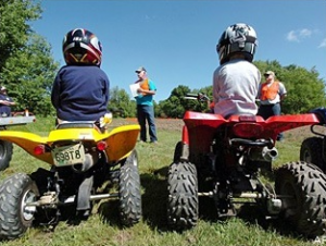children riding ATV