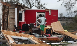 man looking at damage to home