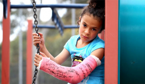 young girl injured on playground